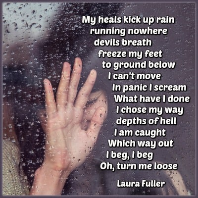 a girl with hand on a window pane in the rain with a poem written on it