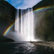 rainbow behind a water fall