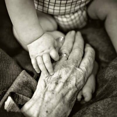 baby and old hands touching