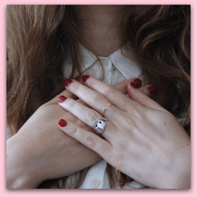 girl with hands over heart