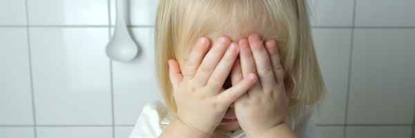 Am I Overreacting-Is It My Fault-Child Abuse Is Not Your Fault kid with hands over face