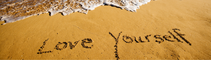 love yourself in sand